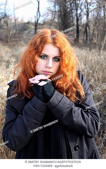 red haired girl outdoors