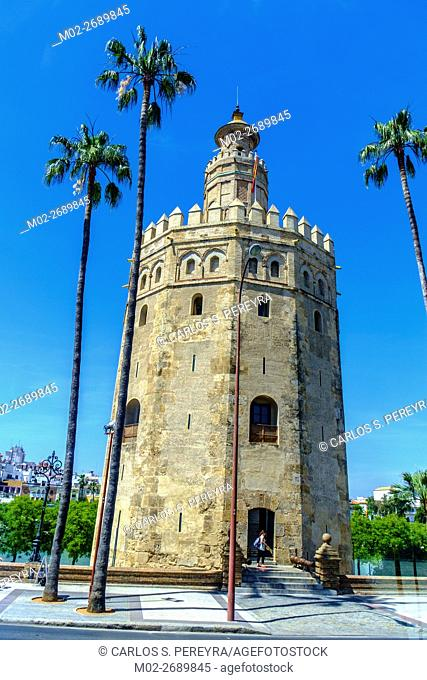 Torre del Oro over Guadalquivir river at a cloudy summer day. Sevilla, Spain