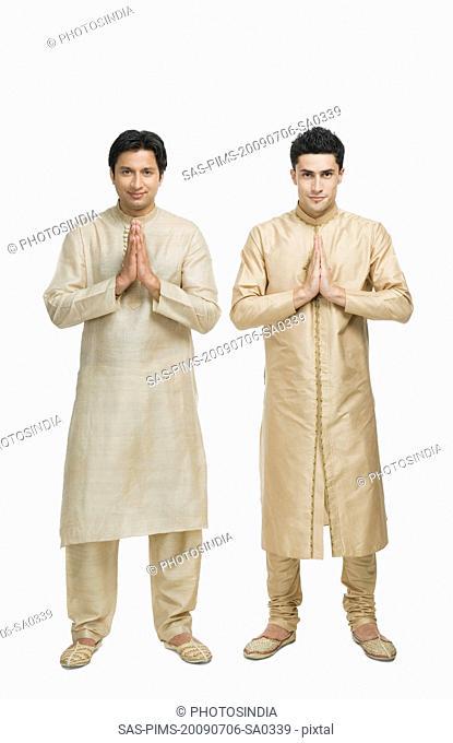 Two men in prayer position