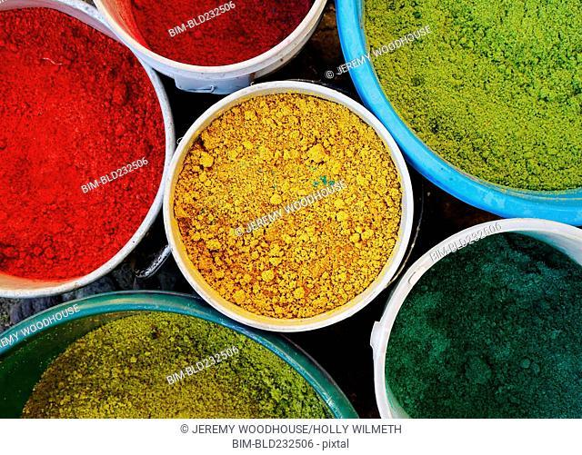 Tubs of multicolor powder