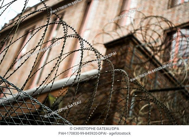 Picture of razor wire with sharp cutting edges on a wall of the Detention Centre in Hamburg, Germany, taken 30 August 2017