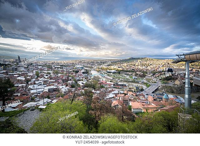 Tbilisi view with Bridge of Peace and Concert Hall seen from Narikala Fortress hill in Tbilisi, Georgia