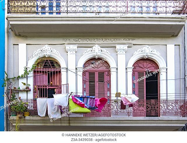 Laundry hanging on the balcony in Old Havana, Republic of Cuba, Caribbean, Central America