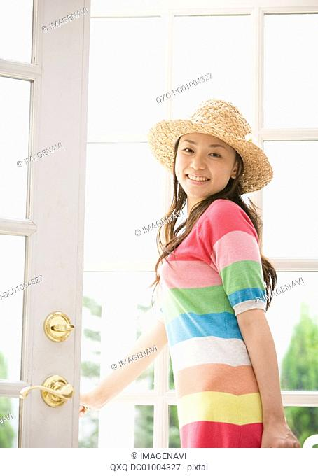 A woman wearing straw hat