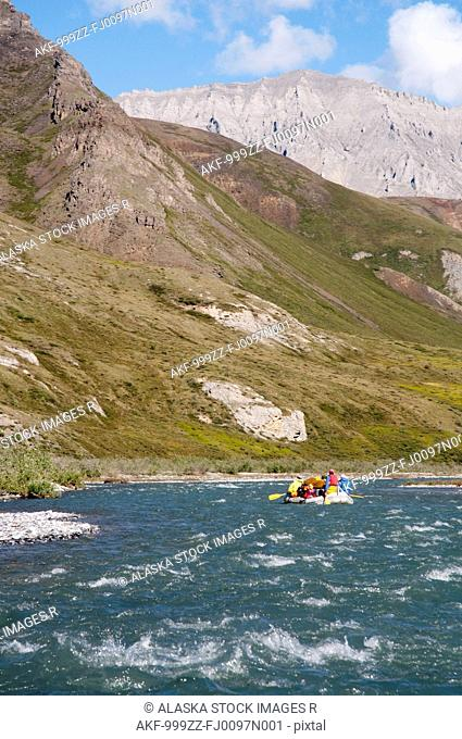 People rafting on the Marsh Fork of the Canning River in the Brooks Range, Arctic National Wildlife Refuge, Alaska, Summer