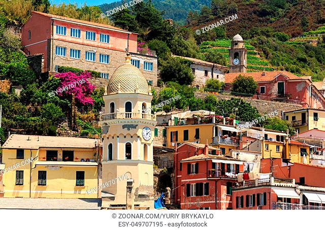 Beautiful summer Vernazza view. One of five famous villages of Cinque Terre National Park in Liguria, Italy, suspended between Ligurian sea and land on sheer...