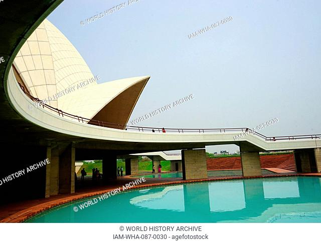 View of the ponds beneath the portico of the Lotus Temple, a Baha'i House of Worship, in New Delhi, designed by Fariborz Sahba (1948-) an Iranian-American...
