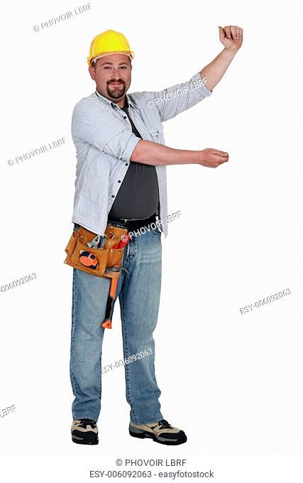 Tradesman holding up an imaginary board