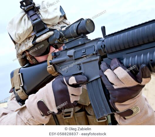 Close-up shot of US marine shooting his rifle
