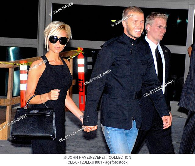 Victoria Beckham (carrying an Hermes Kelly bag), David Beckham out and about for LAX Airport arrival, LAX Airport, Los Angeles, CA, July 12, 2007