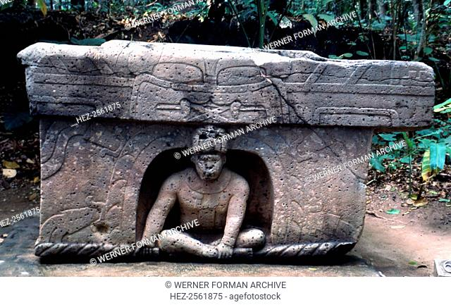 Olmec altar-throne displayed at the archaeological park, Villahermosa, Veracruz. The central figure-ruler is sitting in a niche surmounted by a stylized jaguar...