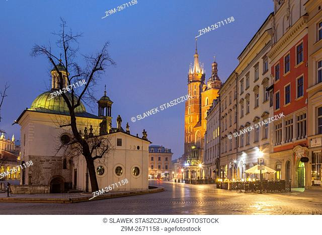 Dawn at Main Market Square in Krakow old town, Poland. St Adalbert church in the foreground, St Mary's church in the distance