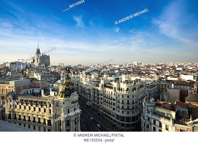Madrid skyline with Metropolis at the front and Gran via leading to Telefonica tower to the rear