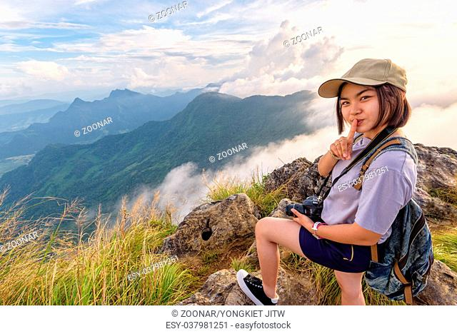 Hiker girl with happy on Phu Chi Fa Mountain