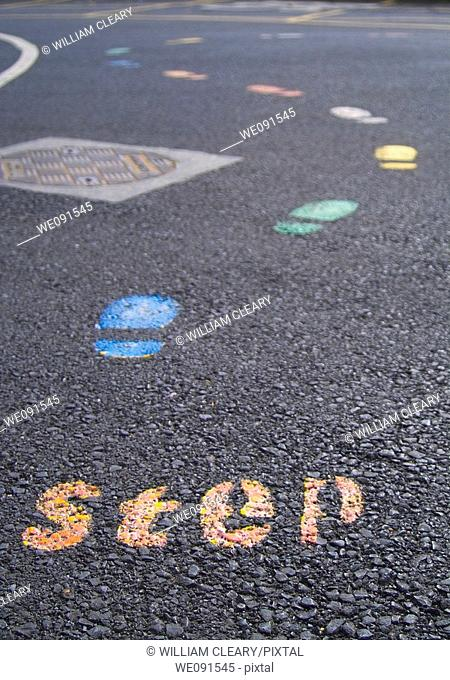 Step...A coloured trail of footprints in a school yard