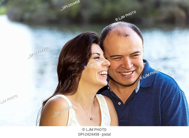 Married couple in a park spending quality time together; Edmonton, Alberta, Canada