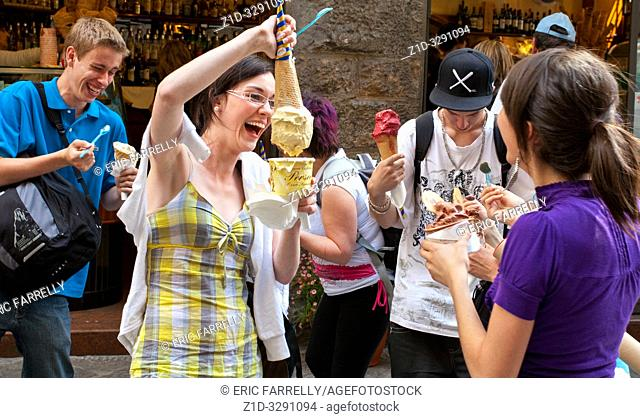 Youths enjoying purchases of Ice cream. Florence Italy
