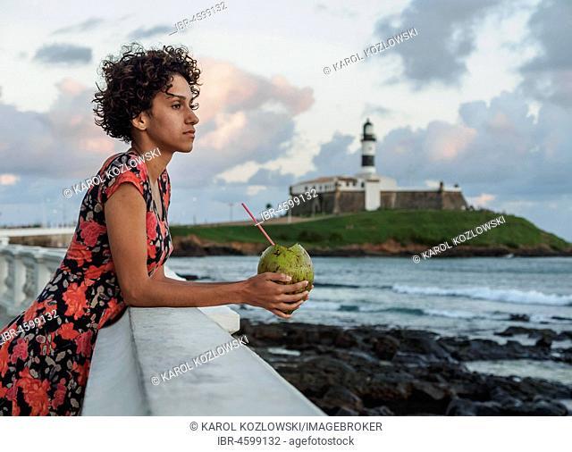 Brazilian Model drinking Coconut Water, Barra, Salvador, State of Bahia, Brazil