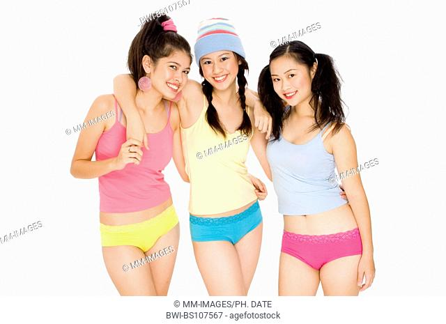 Three young asian women in colorful outfits