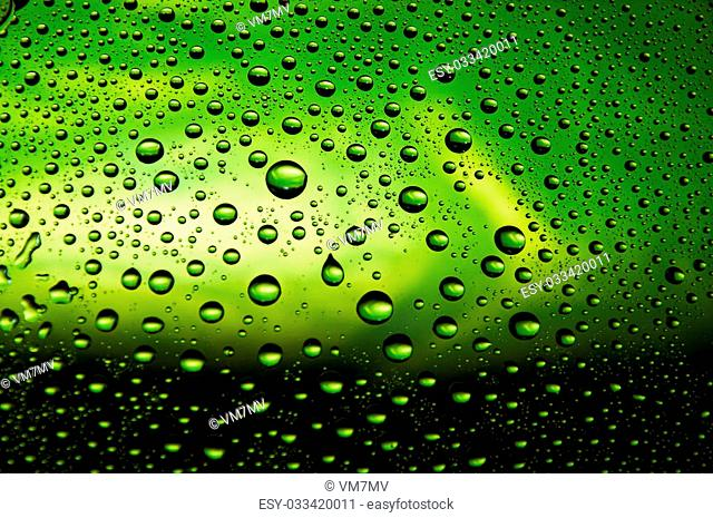 Many little water drops on the glass(yellow, green, black)