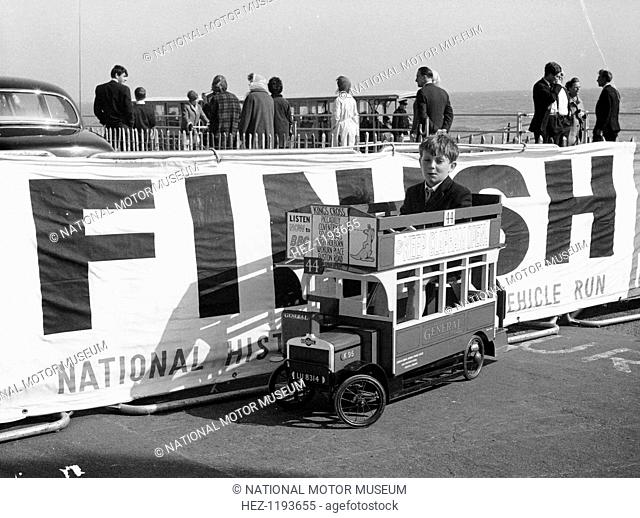 1919 K type AEC miniature bus, 1964. Boy at the finishing line of the London to Brighton Run in 1964