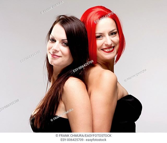 Two Young Female Friends Comparing Wig and Real Hair