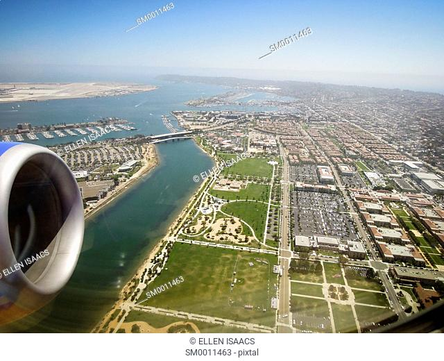 Aerial view of San Diego metropolitan area as seen through the window of a jet airplane while taking off