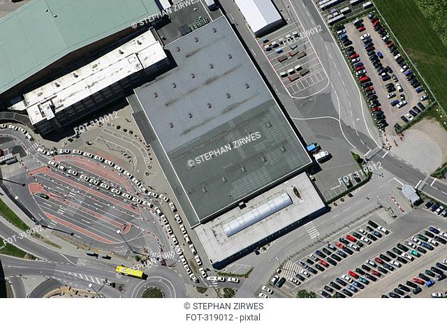 Aerial view of airport roof and parking lot