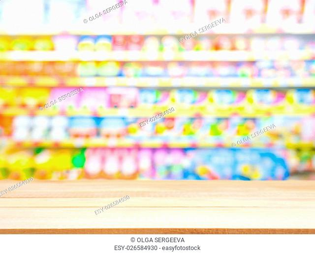 Wooden board empty table in front of blurred background. Perspective light wood over blur in kids toys store - can be used for display or montage your products