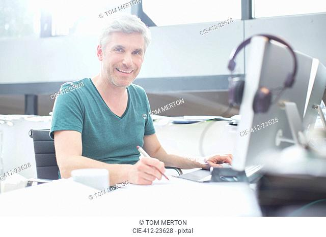 Older man working on computer at desk