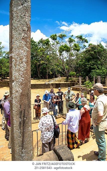 visitors and guide at Anaradhapura in Sri Lanka