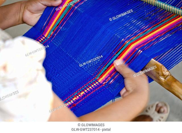 Close-up of a woman weaving textile, Santo Tomas Jalieza, Oaxaca State, Mexico
