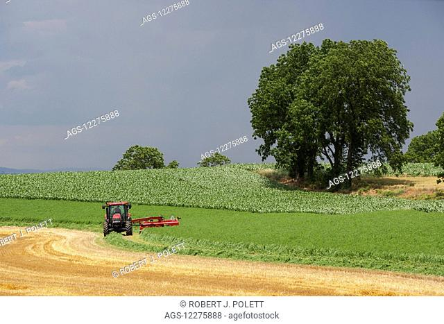 Case IH Tractor with DC132 Disc Mower cutting Alfalfa; Strasburg, Pennsylvania, United States of America