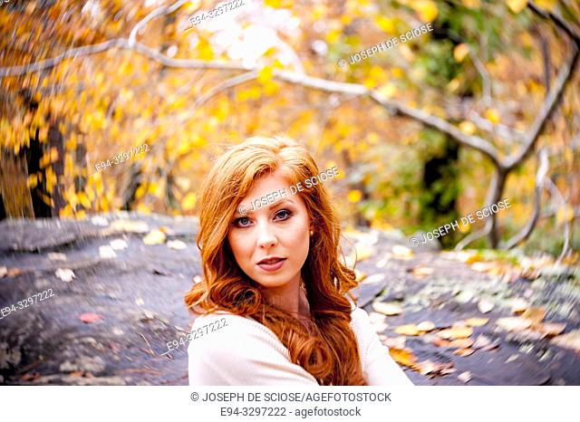 Portrait of a 25 year old redheaded woman in a forest setting