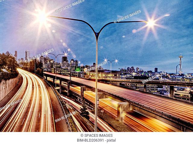 Streetlamp over freeway at night, Seattle, Washington, United States