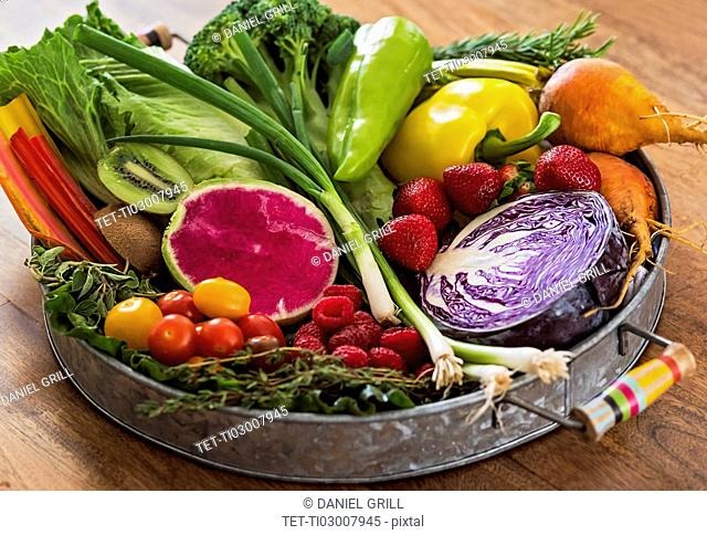 Fruit, vegetables and herbs on tray