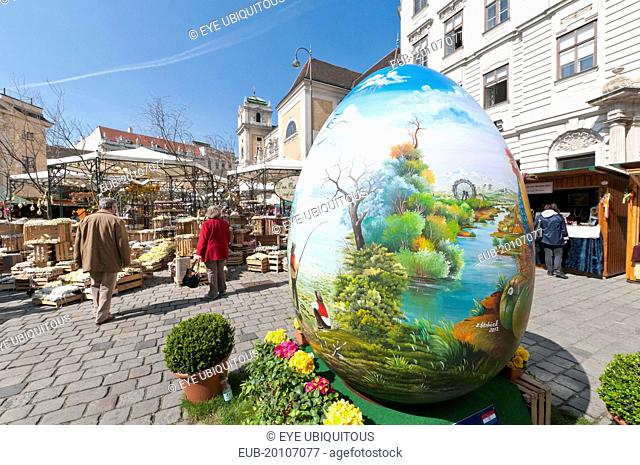 A giant painted egg marks the entrance to the Old Vienna Easter Market at the Freyung