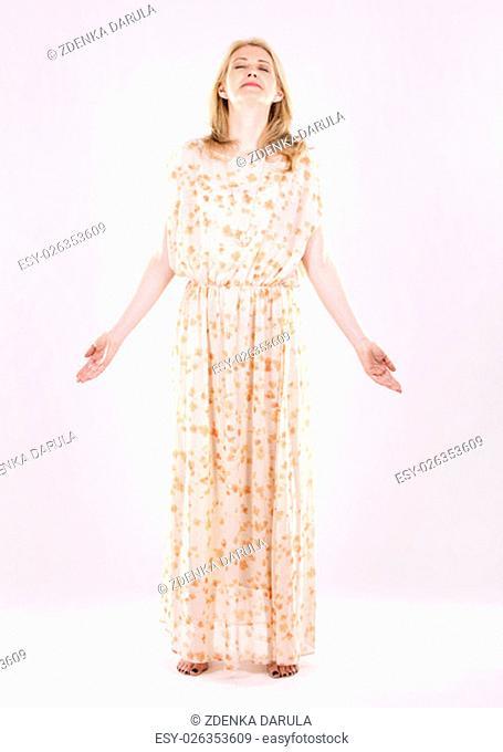 blond woman wearing beige dress on white background
