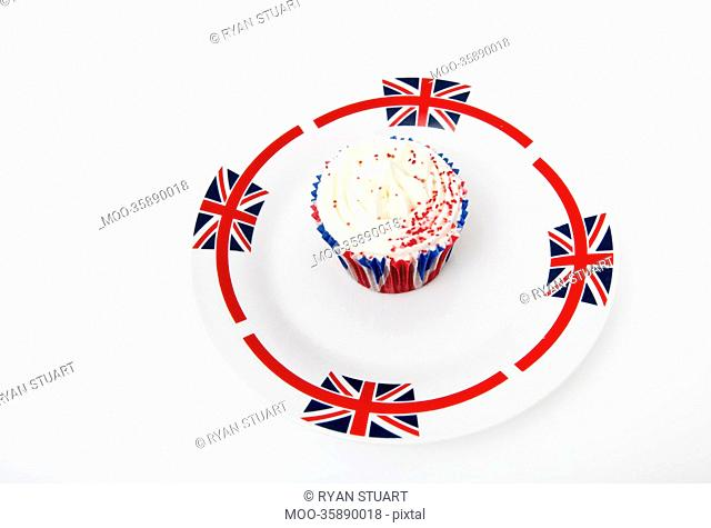 Cupcake in Union Jack plate against white background