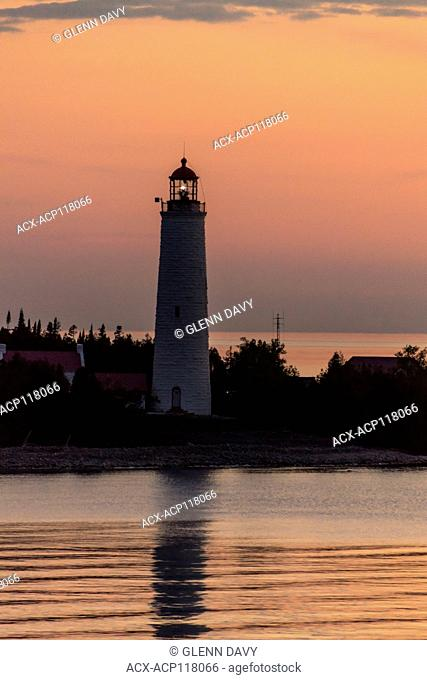 Cove Island Lighthouse w/beacon on at dusk, Georgian Bay, Ontario, Canada