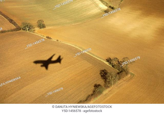 shadow of the plane coming to landing at London Luton Airport, taken from this plane, beautiful fields like carpets down there