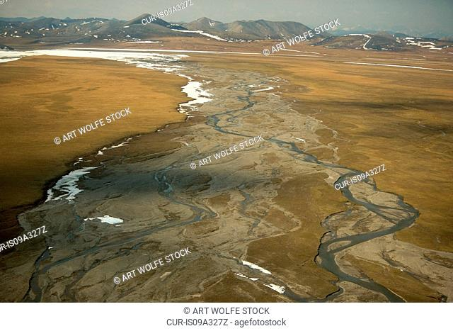A small stream, one of the many with no name, flows north out of the Brooks Range across the Arctic Plains to the Beaufort Sea