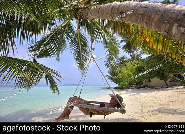 Girl relaxing on the hammock, Biyadhoo island, Maldives