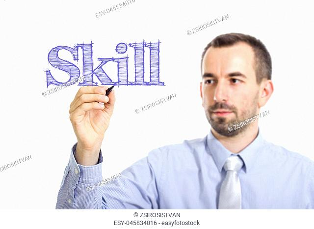 Skill - Young businessman writing blue text on transparent surface - horizontal image