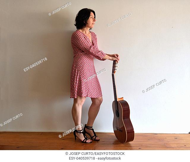 portrait of a woman with a guitar