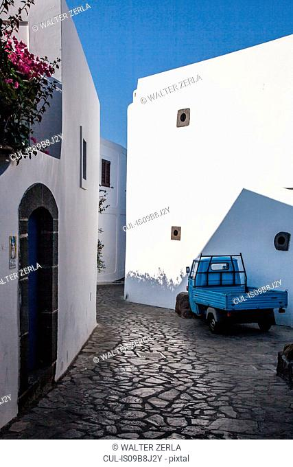Paved road between houses, Panarea, Messina, Italy