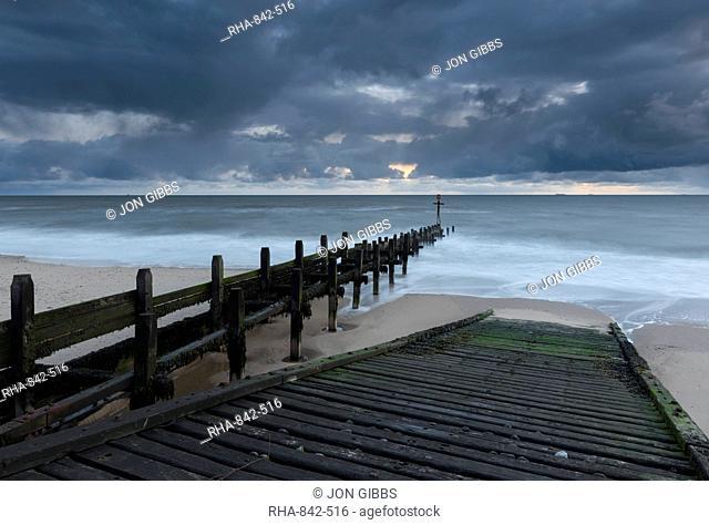 A slipway and groynes on the beach at Walcott, Norfolk, England, United Kingdom, Europe