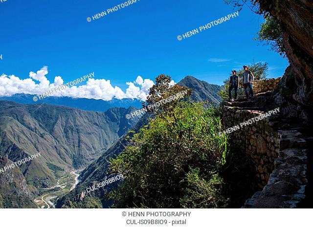 Couple on the Inca Trail path close to Machu Picchu, Cusco, Peru
