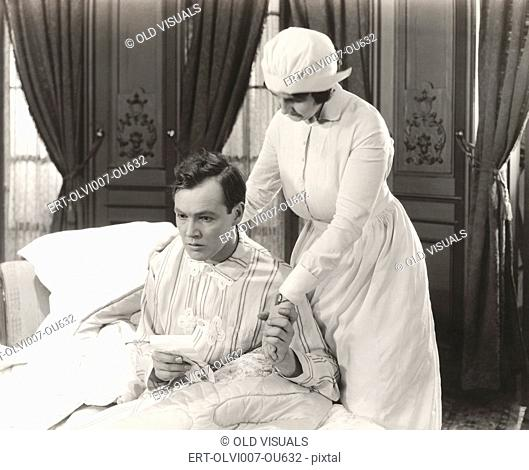 Nurse consoles her patient (OLVI007-OU632-F)
