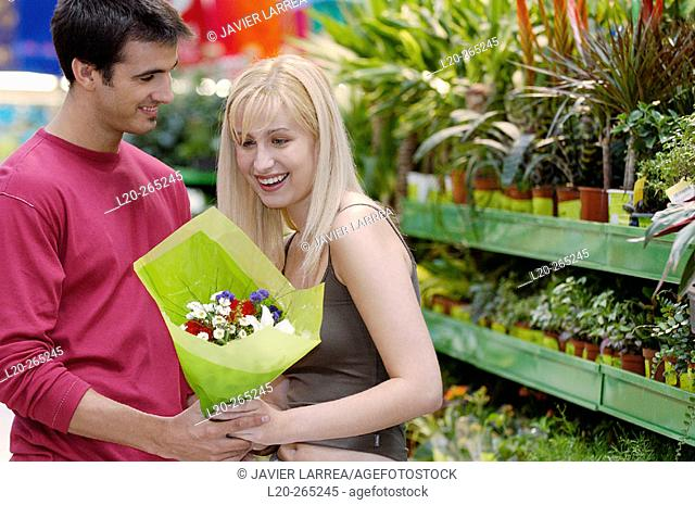 Couple with flower bouquet at shopping center